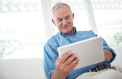Buy stock photo Cropped shot of a senior man using a digital tablet at home