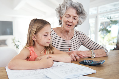 Buy stock photo Shot of a grandmother helping her granddaughter with her homework