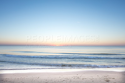 Buy stock photo Shot of a sunset over the ocean