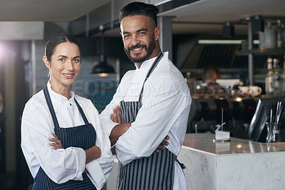 Buy stock photo Cropped portrait of professional cooks standing with their arms folded in the kitchen