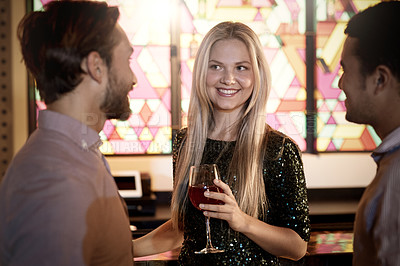 Buy stock photo Shot of three people chatting in a bar