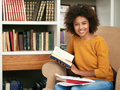 Buy stock photo Cropped portrait of a young woman studying on her sofa