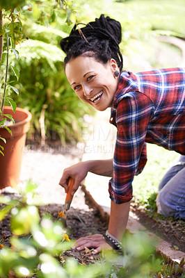 Buy stock photo Cropped shot of a woman enjoying a day of gardening