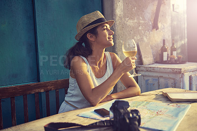 Buy stock photo Shot of a tourist having a glass of wine while taking a break from traveling