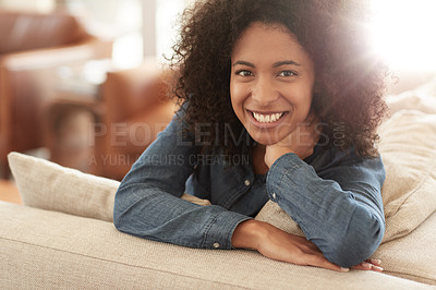 Buy stock photo Portrait of a young woman sitting on the sofa at home