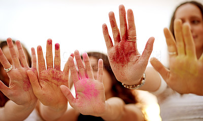 Buy stock photo Shot of a group of girlfriends with their hands full of colorful glitter