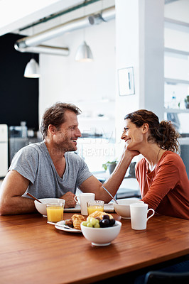 Buy stock photo Shot of a mature couple having breakfast together