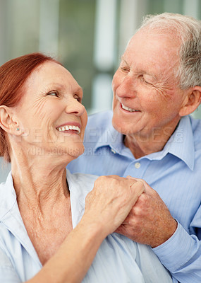 Buy stock photo A loving senior couple looking at one another