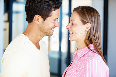 Buy stock photo Romantic couple looking at each other and smiling