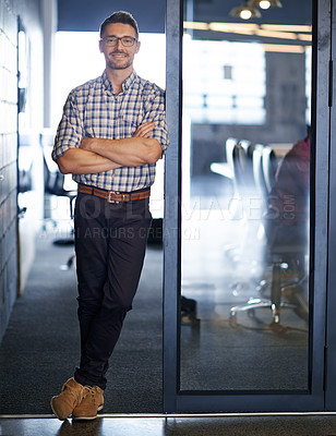Buy stock photo Portrait of an office worker leaning against a glass door