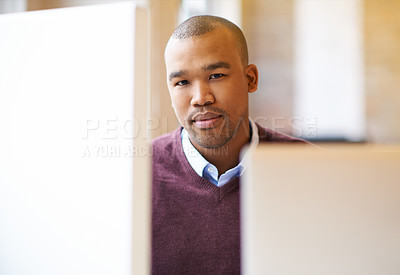 Buy stock photo Shot of a male designer working at his computer