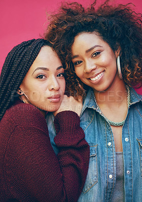 Buy stock photo Portrait of two girlfriends posing against a pink background