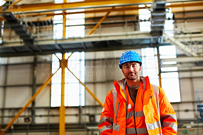 Buy stock photo Portrait of a man in workwear standing in a large industrial building