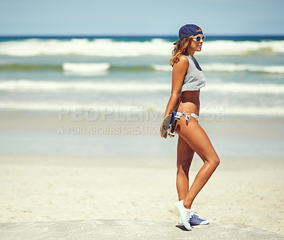 Buy stock photo Shot of a young woman hanging out on the boardwalk with her skateboard