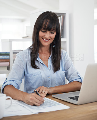 Buy stock photo Cropped shot of a woman working at home