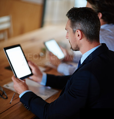 Buy stock photo Shot of businesspeople using their digital tablets during a conference