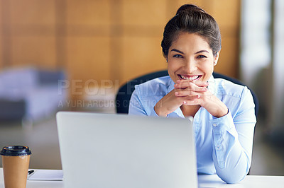 Buy stock photo Portrait of a young businesswoman sitting with her laptop in the office