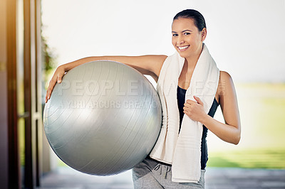 Buy stock photo Cropped portrait of a young woman carrying her exercise ball