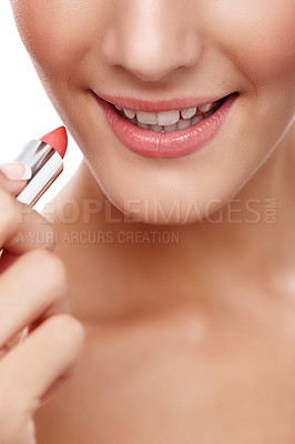 Buy stock photo Closeup studio shot of a beautiful young woman applying lipstick isolated on white