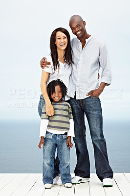 Buy stock photo Portrait of a young family standing outside