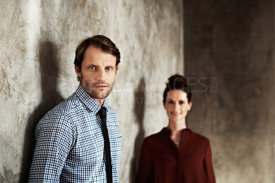 Buy stock photo Portrait of a man with his wife standing in the background