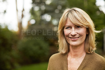 Buy stock photo Portrait of a mature woman standing outside