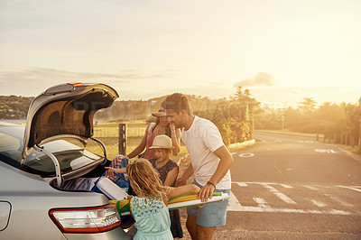 Buy stock photo Shot of a family unpacking the car on their vacation