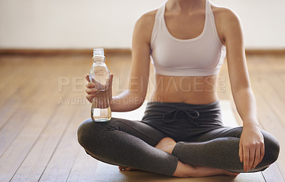 Buy stock photo Cropped shot of a woman having water after her yoga session