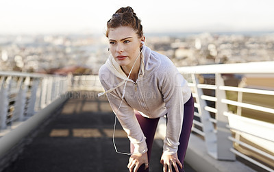Buy stock photo Cropped shot of an attractive young woman looking tired during her morning run