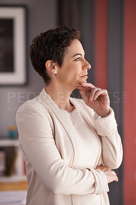 Buy stock photo Shot of a businesswoman looking thoughtful in an office