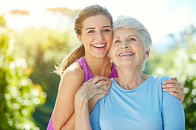 Buy stock photo Cropped portrait of a young woman and her mother in the park