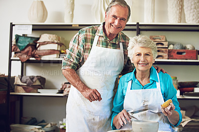 Buy stock photo Portrait of a senior couple making a ceramic pot together in a workshop