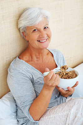 Buy stock photo Portrait of senior woman sitting on bed and having her breakfast