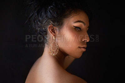 Buy stock photo Cropped shot of a beautiful young woman against a dark background