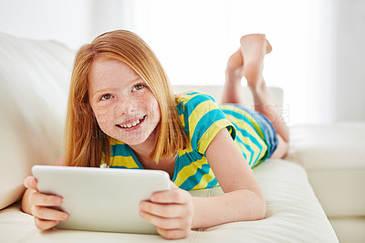 Buy stock photo Shot of a little girl using a digital tablet at home