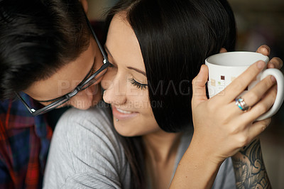 Buy stock photo Shot of an affectionate young couple enjoying coffee together