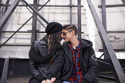 Buy stock photo Shot of a happy young couple sharing a romantic moment out in the city