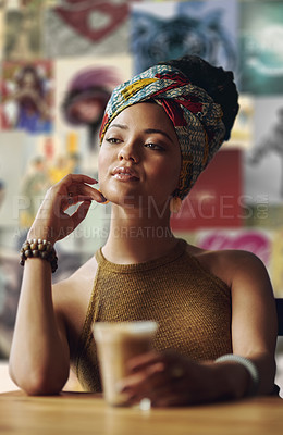 Buy stock photo Cropped shot of an attractive young woman sitting in a coffee shop