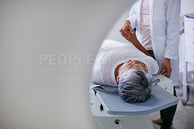 Buy stock photo Shot of a senior woman being comforted by a doctor before and MRI scan