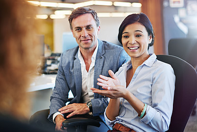 Buy stock photo Shot of a coworkers talking together in an office