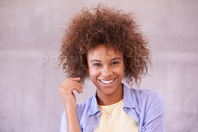 Buy stock photo Studio shot of a young woman smiling at the camera