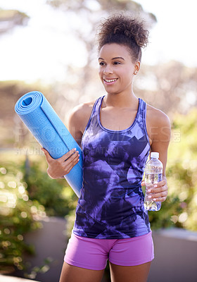 Buy stock photo Shot of an attractive young woman exercising outdoors
