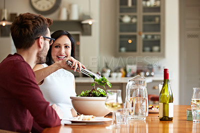 Buy stock photo Shot of a young couple having dinner together