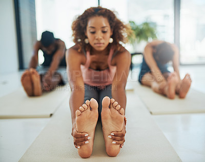 Buy stock photo Shot of a group of people doing yoga