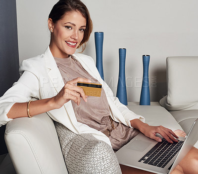 Buy stock photo Shot of a young woman doing online shopping at home