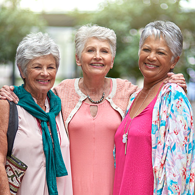 Buy stock photo Cropped portrait of a three senior women out on a shopping spree