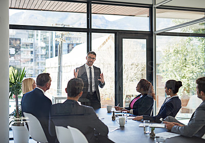 Buy stock photo Shot of an executive giving a presentation to colleagues in a boardroom