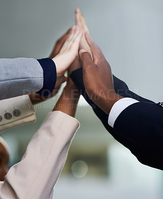Buy stock photo Cropped shot of a group of colleagues giving each other a high five