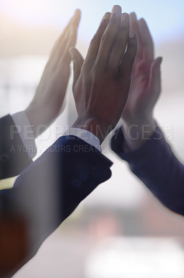 Buy stock photo Cropped shot of a group of businessmen giving each other a high five