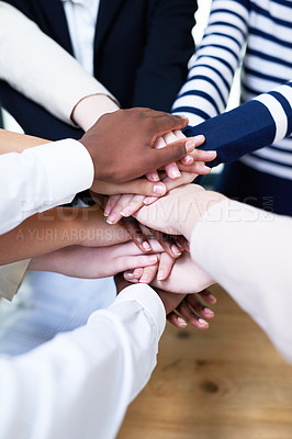 Buy stock photo High angle shot of a group of colleagues standing with their hands in a huddle